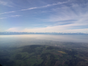 Picture window view out of a private jet over Friedrichshafen