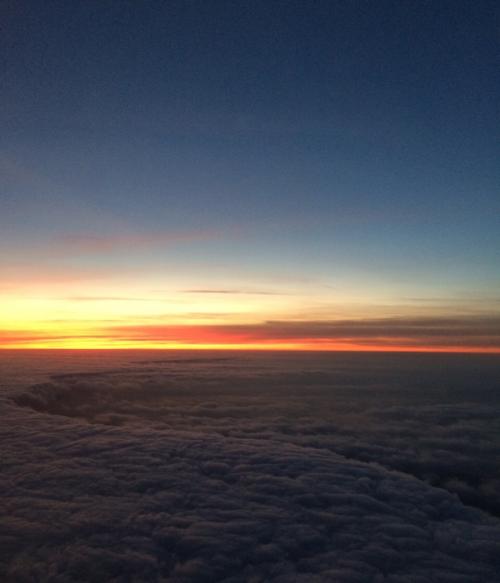 Zonsondergang vanuit een lucht taxi
