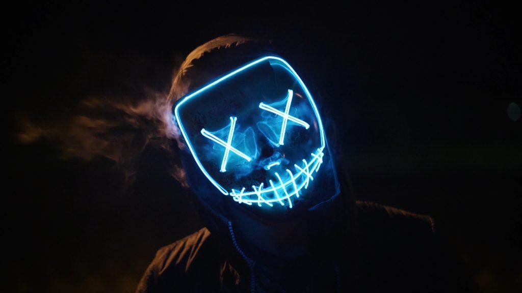 man wearing mask hardstyle festival