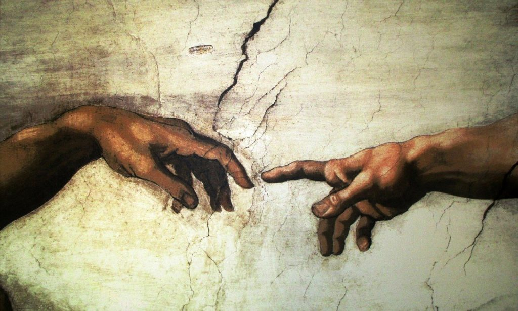 The creation of Adam by artists Michelangelo Buonarroti
