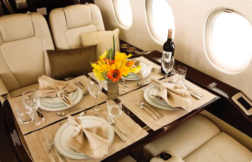 Having dinner in a private jet